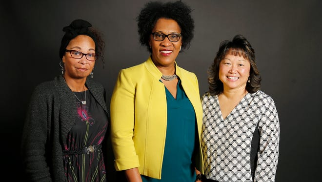 (left to right) Tanisha Agee-Bell, Mina Jefferson and Susan Stockman pose in the Enquirer Studio in downtown Cincinnati on Thursday, Feb. 8, 2018. The three women are mothers to sons who have recently been the victims of racist behavior.