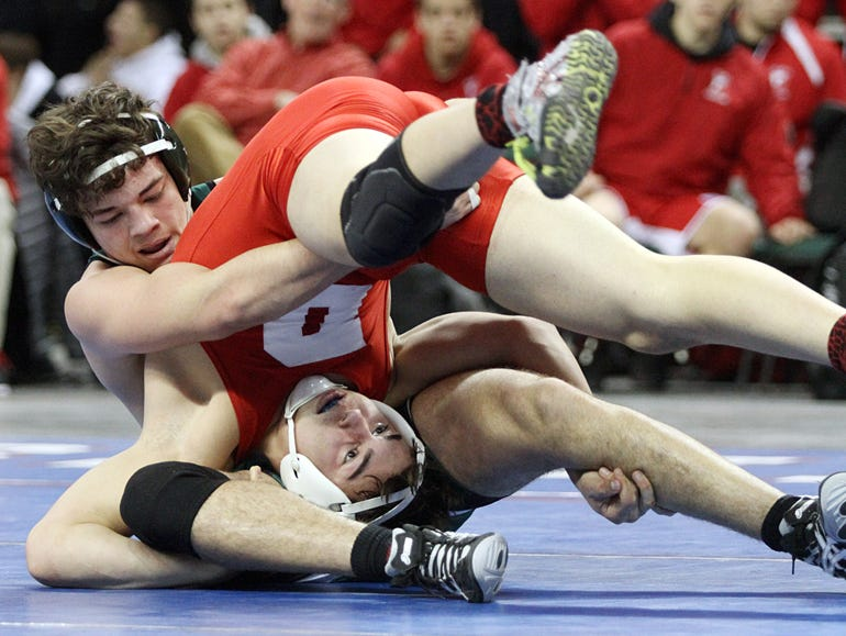 Vince Degeorge of Delsea, right, takes on Christian Gonzalez of South Plainfield in a 182lb semifinal match at the Sun Bank Arena in Trenton, NJ.
