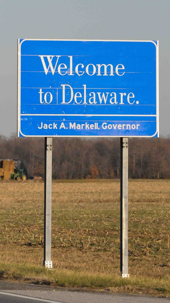 """The """"Small Wonder"""" signs were replaced piecemeal over several years by white-on-blue placards that say simply, """"Welcome to Delaware."""" This one is in Kent County."""