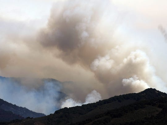 Smoke from both controlled burns and the Soberanes