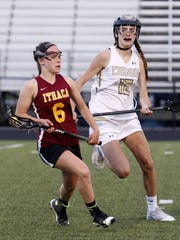 Ithaca's Zoe Getzin looks for room as Corning's Lindsey