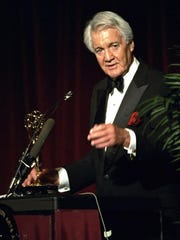 Pat Summerall, completing his 34th and final season with CBS, receives an award for lifetime achievement April 19, 1994, during the Sports Emmy Awards in New York. The NFL player-turned-broadcaster whose deep, resonant voice called games for more than 40 years died April 16, 2013, at age 82.
