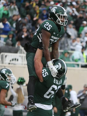 Michigan State's Darrell Stewart celebrates his touchdown Penn State with Brian Allen during first quarter action Saturday, November 4, 2017 at Spartan Stadium in East Lansing.