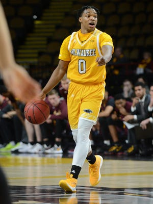 UW-Milwaukee guard Bryce Barnes directs the offense on Saturday, December 16, 2017, at the UW-Milwaukee Panther Arena.