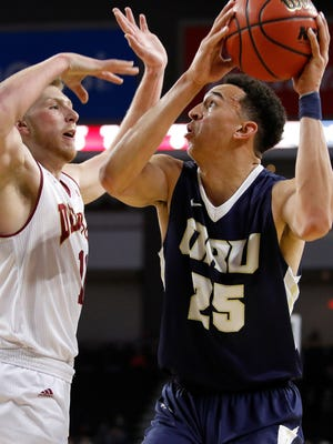 Javan White #25 of Oral Roberts goes up for a shot while defended by Jake Krafka #11 of Denver at the 2018 Summit League Basketball tournament at the Denny Sanford Premier Center in Sioux Falls. (Photo by Dick Carlson/Inertia)
