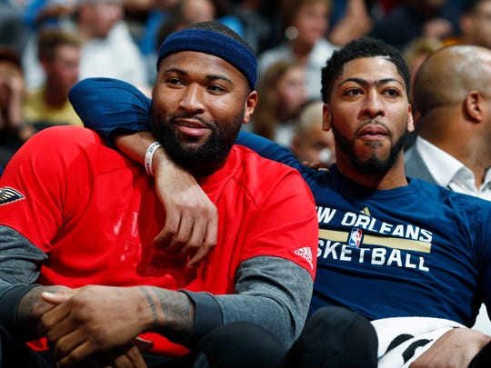 "FILE - This April 7, 2017 file photo shows New Orleans Pelicans forwards DeMarcus Cousins, left, and Anthony Davis joking with each other as they sit on the bench and watch the second half of the team's NBA basketball game against the Denver Nuggets in Denver. The Pelicans' back-to-the-future experiment, centered on the All-Star front-court duo of Davis and Cousins, begins in earnest now. The stakes are high and immediate, because a third-straight non-playoff season could spell regime change, as well as an exodus of players, including Cousins, who are in the final season of their contract. Davis says Pelicans players know they've got ""one year to basically figure it out."" Cousins says he senses a ""special season"" coming. (AP Photo/David Zalubowski, file)"