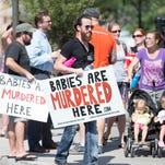 Protesters attend an anti-abortion rally in Tempe in July.