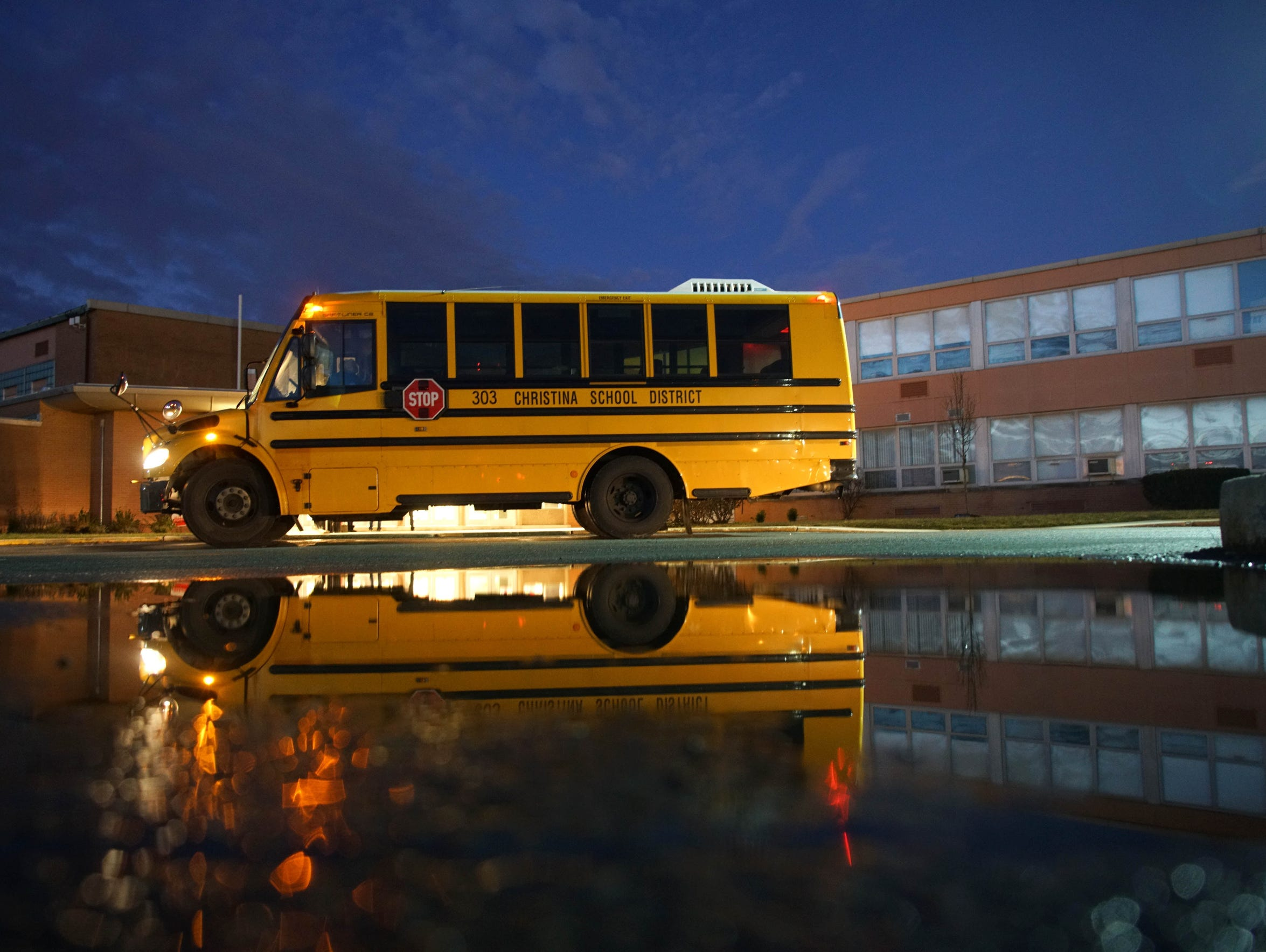 A school bus sits outside of Christiana High School