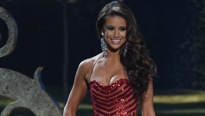 Miss USA Nia Sanchez, from Las Vegas, participates in the evening gown competition during the 63rd Miss Universe pageant Sunday in Miami.