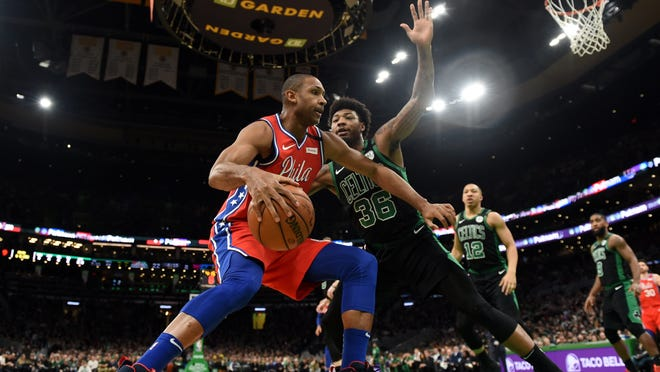Philadelphia 76ers forward Al Horford (42) controls the ball while Boston Celtics guard Marcus Smart (36) defends during the first half at TD Garden on Feb. 1, 2020.