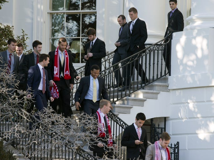 Members of Indiana University Men's Soccer team walk down steps of the White House as they arrive to listen to President Barack Obama speak to the 2012-13 NCAA Division I Men's and Women's champions on the South Lawn of the White House at Washington, on Monday, March 10, 2014.