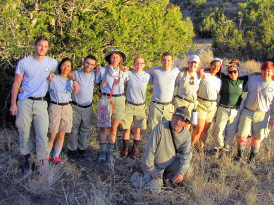 National Civilian Community Corps members of an AmeriCorps-sponsored team relax for a photographer to commemorate their time at Fort Stanton National Conservation Area. They complete an average of 1,850 hours of service per 10 month term.