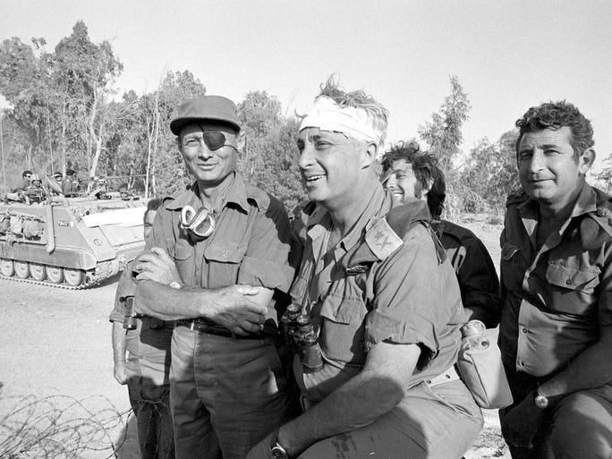 Ariel Sharon and Moshe Dayan, left, survey the western side of the Suez Canal during the Yom Kippur war in October 1973.