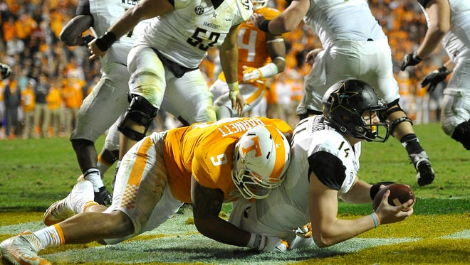 Tennessee defensive end Derek Barnett (9) tackles Vanderbilt quarterback Kyle Shurmur (14) in the end zone for a safety on Nov. 28. The Vols won 53-28.
