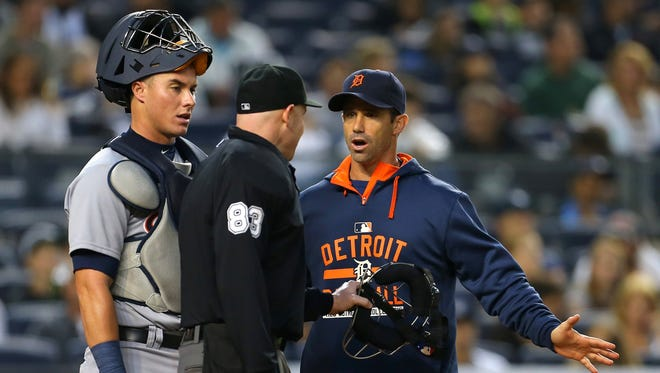 Detroit Tigers manager Brad Ausmus (7) and catcher James McCann (34) have words with home plate umpire Mike Estabrook (83) against the New York Yankees during the second inning at Yankee Stadium.