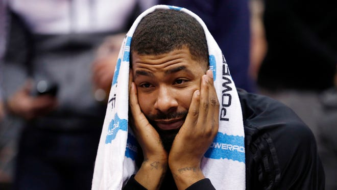 Dec 21, 2015: Phoenix Suns forward Markieff Morris (11) sits the bench in the final second of their 110-89 loss to the Utah Jazz at vivint.SmartHome Arena.