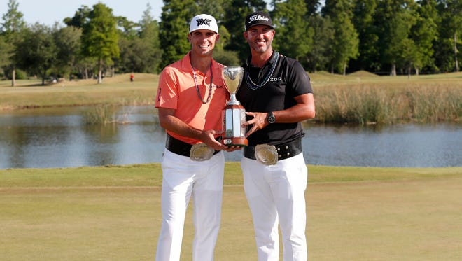 Billy Horschel, left, and teammate Scott Piercy hold their trophy after winning the PGA Zurich Classic on Sunday.