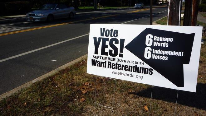 Supporters of the ward system in Ramapo placed lawn signs, encouraging people to vote for the change.