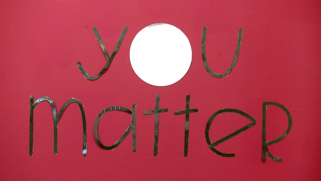 A sign of encouragement on the wall at Woodridge Elementary School for students arriving for the first day of school on Monday, Aug. 31, 2020, in Cuyahoga Falls, Ohio.