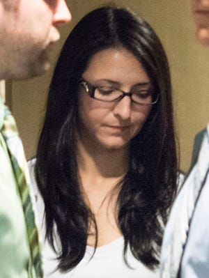In a Tuesday, June 3, 2014 photo, Emma Czornobaj is pictured at the Montreal Courthouse in Montreal.