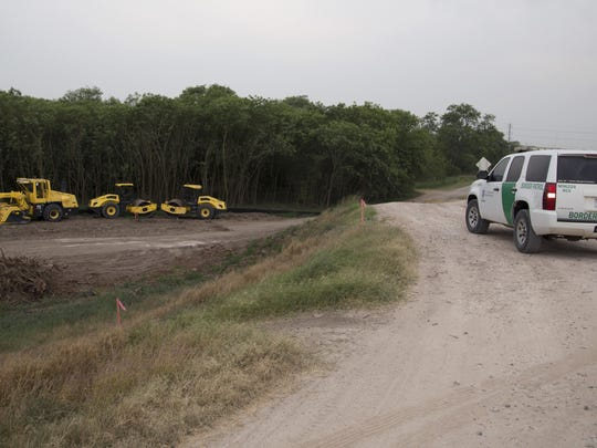 In this April 29, 2019, photo, construction equipment sets in an area of demolished trees and brush where construction is set to begin soon, in Mission , Texas. The cleared area included a mix of trees, including mesquite, mulberry and hackberry, used to protect birds during the ongoing nesting season. According to plans CBP published last year, the cleared land will be filled in and a concrete wall will be installed, with bollards measuring 18 feet. (AP Photo/Eric Gay)