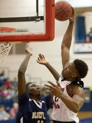 Southern Indiana's DayJar Dickson (23) slams over Bluefield State's Joseph Adeyemo during their game at the PAC Monday night. The Screaming Eagles won 122-59 to remain undefeated on the season.
