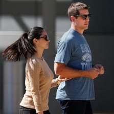Green Bay's quarterback Aaron Rodgers and actress Olivia Munn walk to the set of a commercial filmed outside of the Fox Valley Performing Arts Center on Tuesday, September 16, 2014, in Appleton, Wis.  Joshua Bessex/ Post-Crescent Media