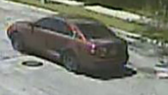 The 2007 red Kia Optima sedan wanted in connection with the fatal shooting of Juan Bernal