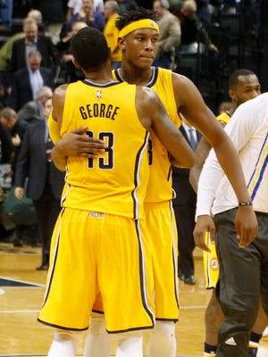 Indiana Pacers forward Paul George (13) is congratulated by center Myles Turner (33) after the game against the Portland Trail Blazers at Bankers Life Fieldhouse.