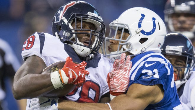 Houston Texans running back Alfred Blue (28) is brought down by Indianapolis Colts cornerback Jalil Brown (31), during fourth quarter action, Lucas Oil Stadium, Indianapolis, Sunday, Dec. 20, 2015. Indianapolis lost to Houston 10-16.