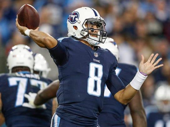 Tennessee Titans quarterback Marcus Mariota (8) drops