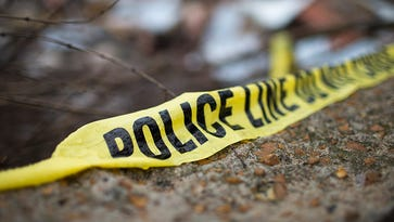 Novi police search wooded area after body found