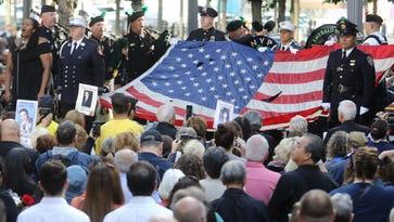 Crowds thin, but 9/11 ceremony draws families to Ground Zero
