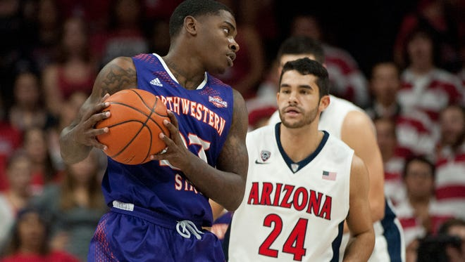 Northwestern State Demons guard Zeek Woodley (23) looks to pass as Arizona Wildcats guard Elliott Pitts (24) defends during the second half at McKale Center. Arizona won 61-42.