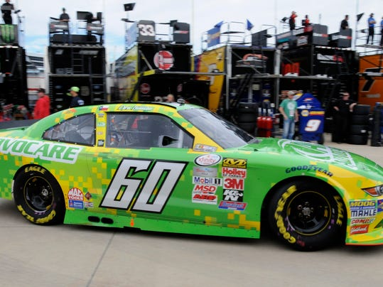 Chris Buescher drives in the garage during NASCAR Xfinity auto race practice at Texas Motor Speedway, Friday, Nov. 6, 2015, in Fort Worth, Texas. (AP Photo/Larry Papke)
