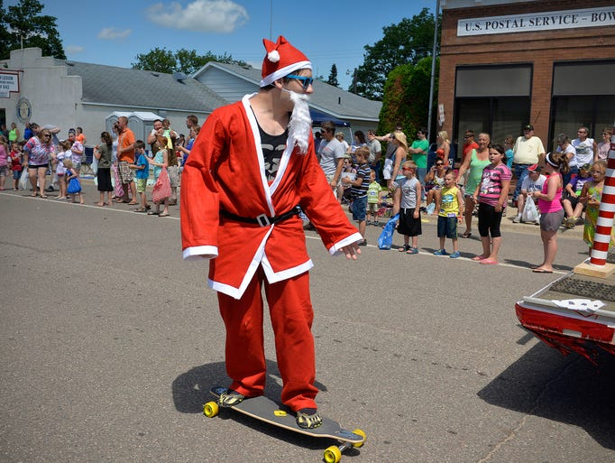 A skateboarding Santa seems oddly out of place on a 90-degree summer day Sunday during the Bowlus Fun Day parade. Santa was from Haven Hill Cabinets and the float featured elves sanding things in their workshop.