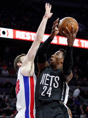 Mar 30, 2017; Auburn Hills, MI, USA; Nets forward Rondae Hollis-Jefferson shoots as Pistons forward Jon Leuer defends during the first quarter at the Palace.