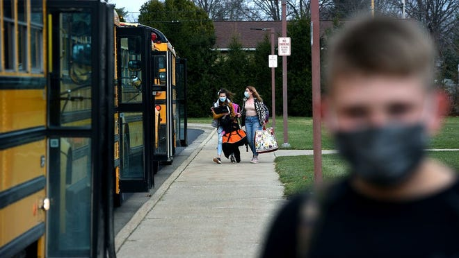 Summerfield Schools students wear masks as they board buses. A Centers for Disease Control and Prevention mandate requires masks on public transportation, including school buses.