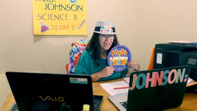 Innes middle school science teacher Kristy Johnson wishes a student a happy birthday Wednesday from her basement home office in Wadsworth.