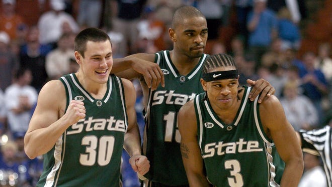 Tim Bograkos (30), Alan Anderson and Shannon Brown (3) celebrate after MSU's double overtime win over Kentucky on March 27, 2005. The win put the Spartans in the Final Four, the fourth of coach Tom Izzo's career.