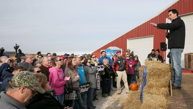 Wisconsin Gov. Scott Walker address a crowd of about 200 during a campaign at a farm and workshop owned by Chuck Brand of Brand Construction in Franksville, Wis., Sunday, Nov. 2, 2014.  Supporters also sang happy birthday to Gov. Walker and one had a cake to present to him.  Here Gov. Scott Walker addresses the crowd of supporters. (AP Photo/Milwaukee Journal-Sentinel, Michael Sears)