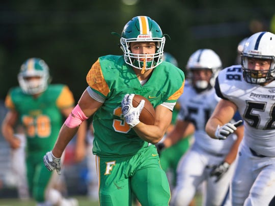 Floyd Central's Jason Cundiff heads into the end zone for one of his three touchdowns in the Highlanders 62-19 win over Providence.
