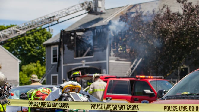 Firefighters battle a blaze at an affordable housing complex managed by Champlain Housing Trust at 36 South Meadow Drive in Burlington's South End on Saturday, June 9, 2018.