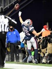 Patriots wide receiver Chris Hogan (15) throws the