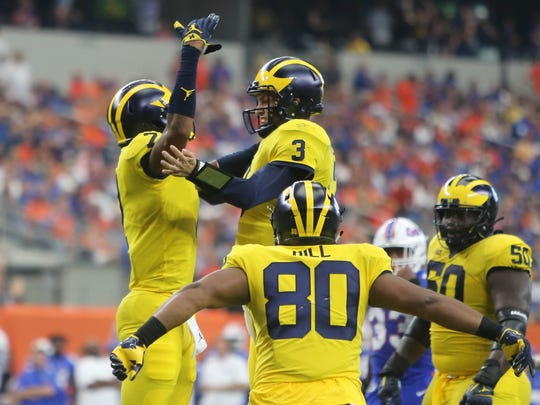 Michigan's Tarik Black, left, celebrates with Wilton