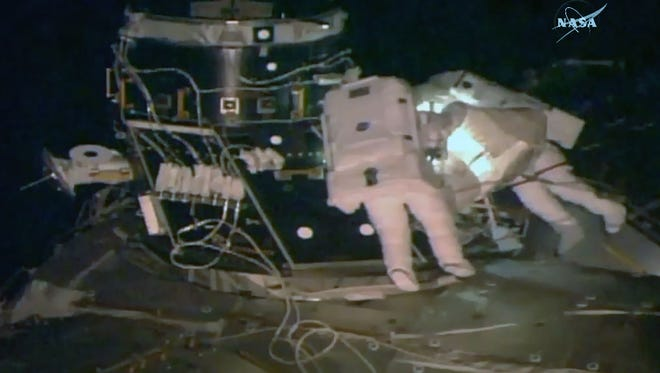 This NASA TV video grab shows US astronaut Peggy Whitson(L) and Shane Kimbrough outside the International Space Staion on March 30, 2017.