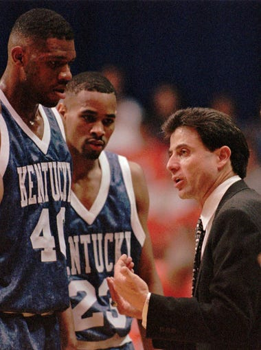Then-Kentucky coach Rick Pitino talks with players Anthony Epps (25), Walter McCarty (40), and Derek Anderson (23) during a timeout against Auburn at Beard-Eaves Memorial Coliseum in Auburn, Ala., on Tuesday, Feb. 27, 1996. The top-ranked Wildcats beat Auburn 88-73. (AP Photo/John Reed)