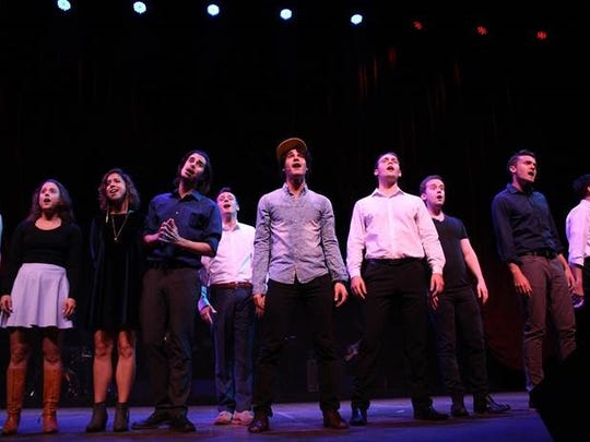 """Darren Criss (center, in hat) and members of StarKid at Thursday's sound check for """"A Very StarKid Reunion"""" in  Ann Arbor, part of the University of Michigan's centennial celebration of the theater department."""