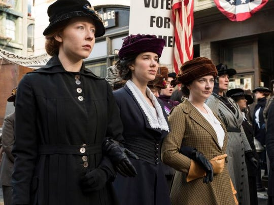 """Gulf Shores/Foley, Alabama native Glennellen Anderson, left, walks alongside actresses Erica Dasher, who plays Alice Paul, and  Lauren Baldwin in a still photo from the NBC """"Timeless"""" episode """"Mrs. Sherlock Holmes."""""""