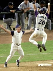Luis Gonzalez of the Diamondbacks celebrates with Eddie